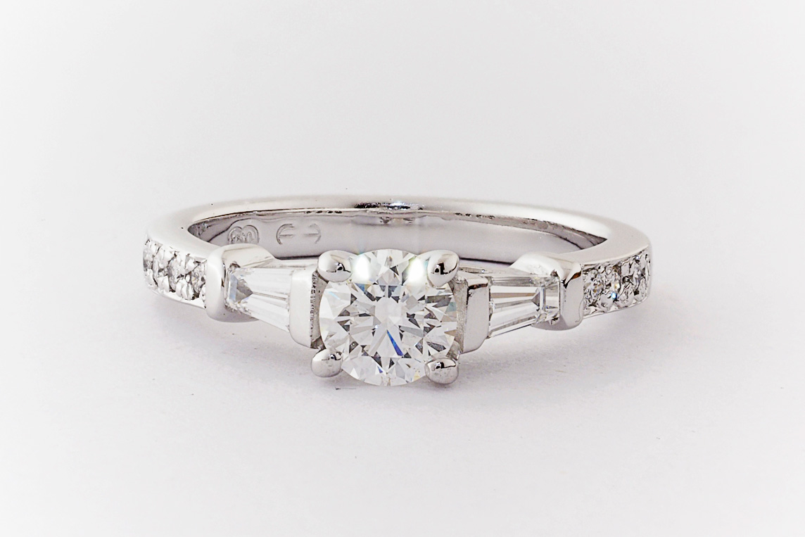 Round Brilliant Cut And Tapered Baguette Diamond Hand Made Engagement Ring Everettbrookes Jewellers